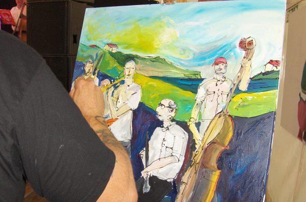 En kunstner malede Royal Garden Jazzband, mens vi spillede. Dette billede arbejder han videre på. Det kommer senere her på hjemmesiden.